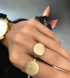 Two round shaped designer gold jewellery rings with a diamond from NordByThomsen