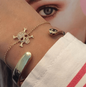 Designer Gold bracelets with a diamond studded skull from Libelula Jewellery