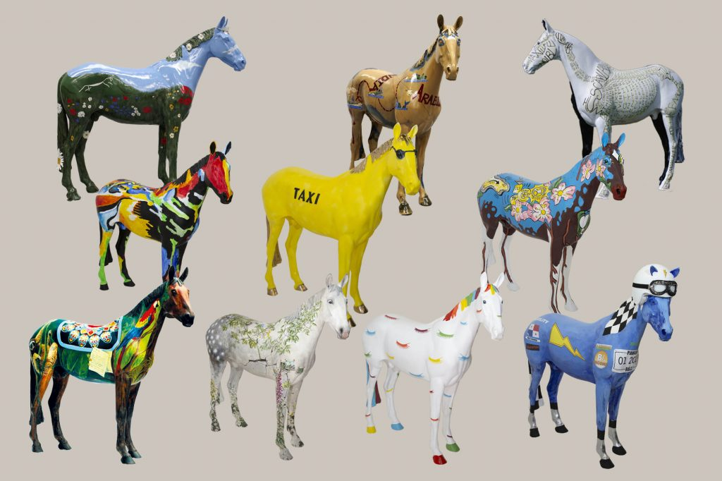 Ten colourful horse sculptures