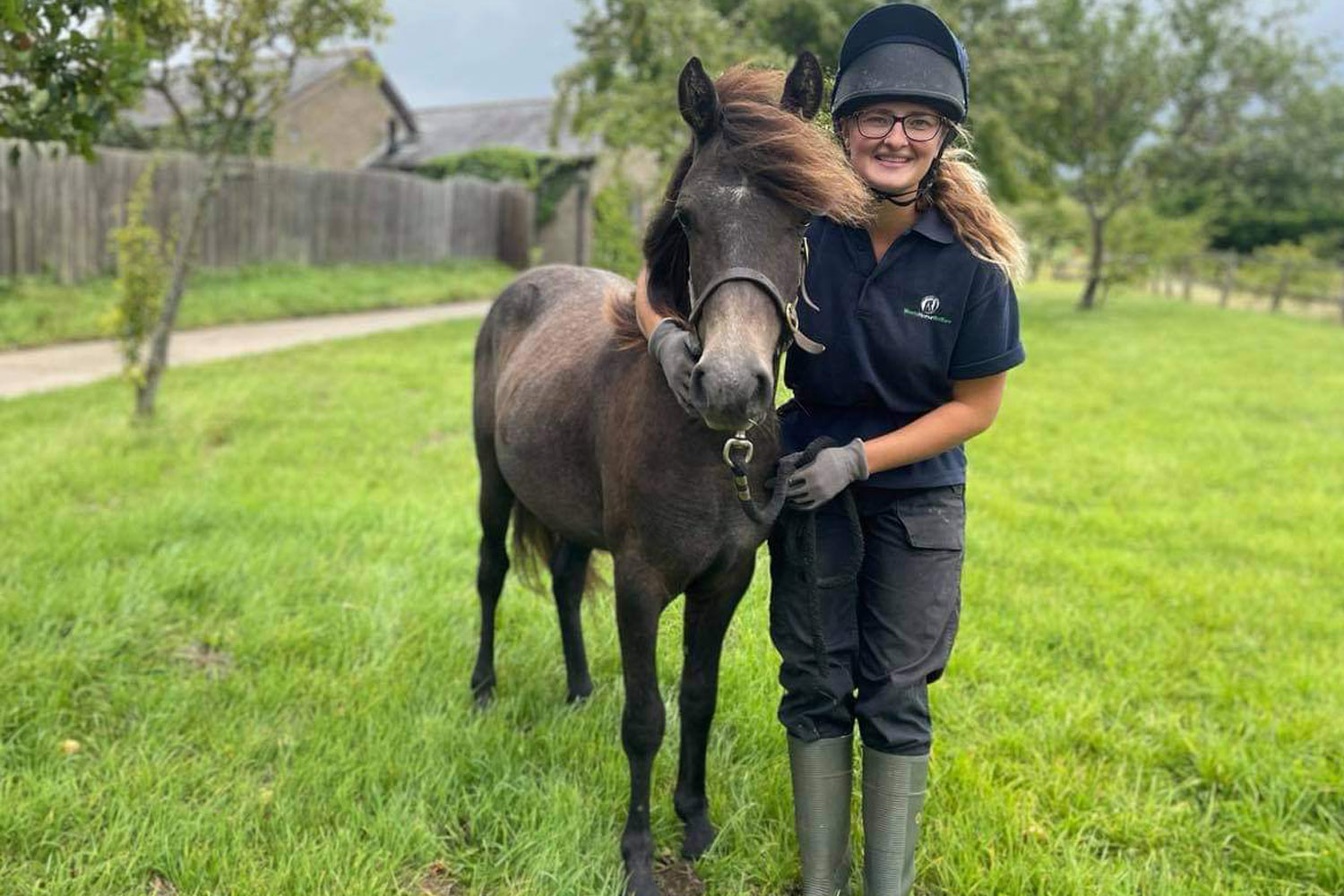 Member of the Glenda Spooner farm team and a young horse