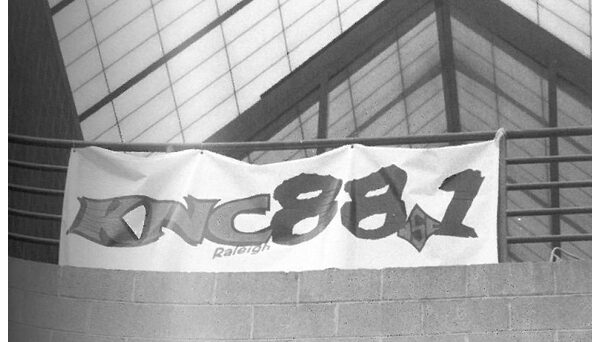 WKNC banner hanging from third floor railing of Witherspoon Student Center. Photo from 1999 Agromeck by Jamie Stevens.