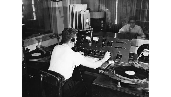 Student in control room, circa 1952. Photo from University Archives.