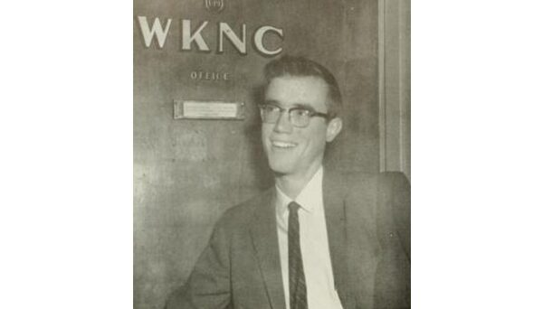 General Manager Kent Weston in front of the WKNC offices on the third floor of the 1911 Building. Photo from 1960 Agromeck.