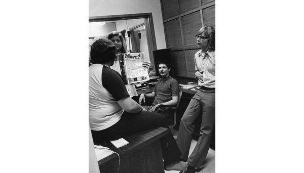 Students in the WKNC offices holding the Aug. 12, 1972 Billboard magazine. Photo from University Archives.