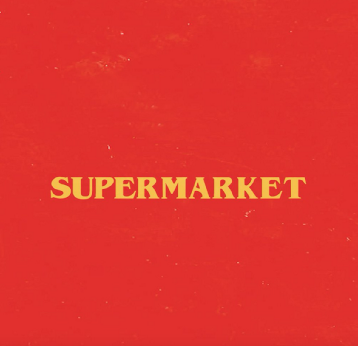 "Yellow words that say ""Supermarket"" on a red background."