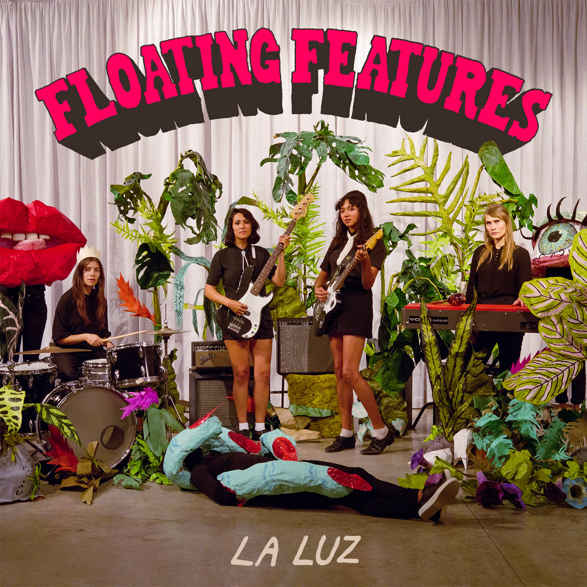 "Album cover of ""Floating Features"" with all four band members on the front"