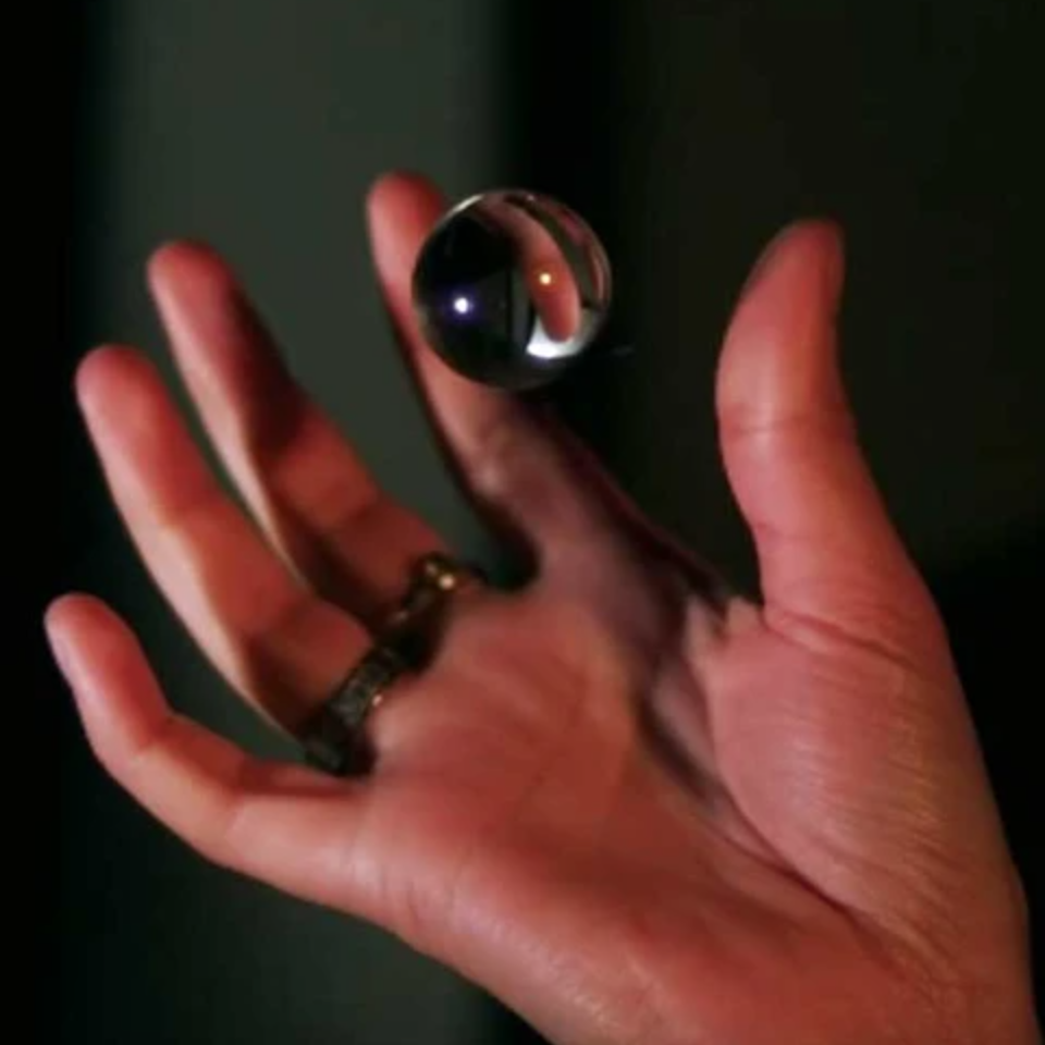 Hand holding glass ball