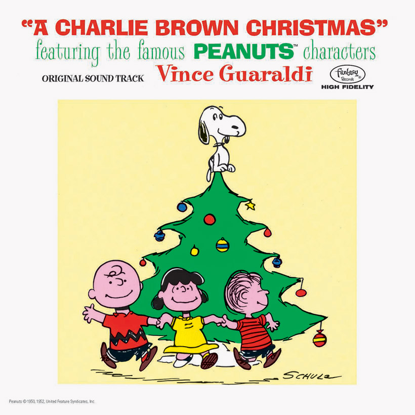 A Charlie Brown Christmas Soundtrack Cover with the Peanuts characters dancing around a Christmas tree