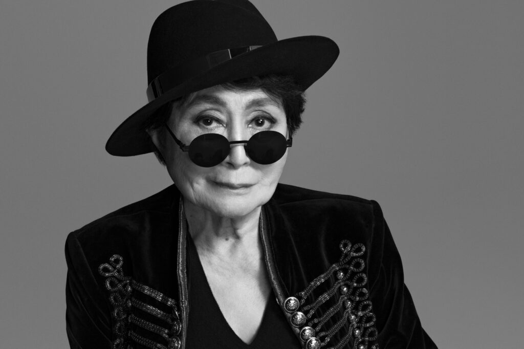 Yoko Ono posing for a publicity image in all black