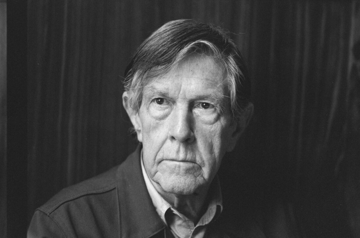John Cage stands in an old black and white photo