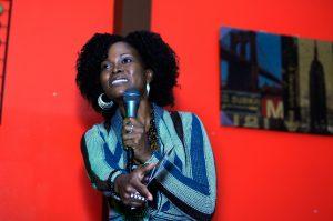 Abiola Abrams speaking at black women's event.