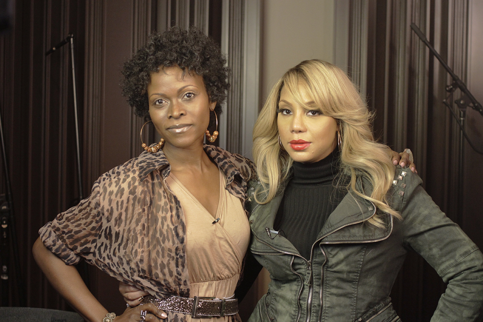Abiola Abrams & Tamar Braxton posing for the interview.