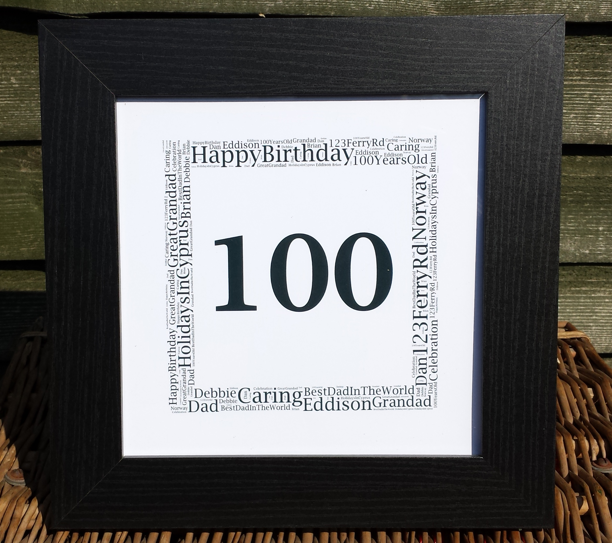 100th Birthday Word Art Frame in a black frame | MadeAt94