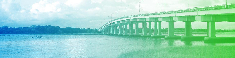 boat passing under interstate bridge