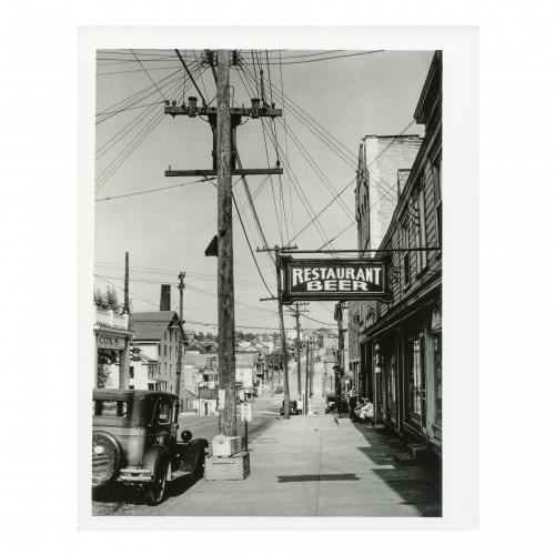 Sidewalk Scene with Pedestrians and Restaurant Sign, Main Street, Mt. Pleasant, Pennsylvania