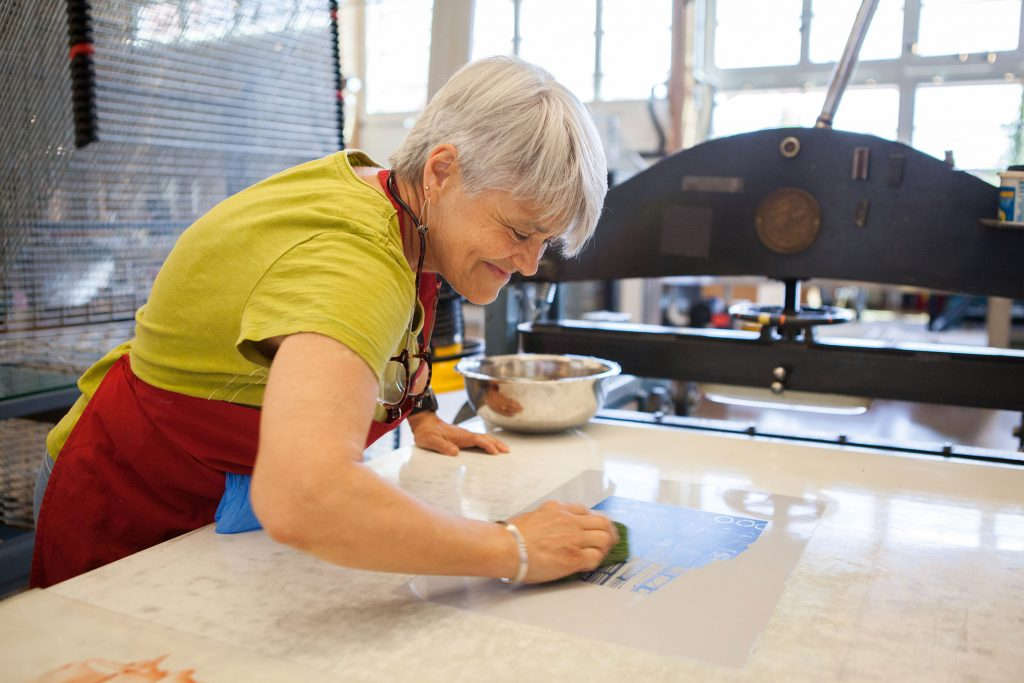 Vickie Stevenson working on a plate in the Lithography workspace