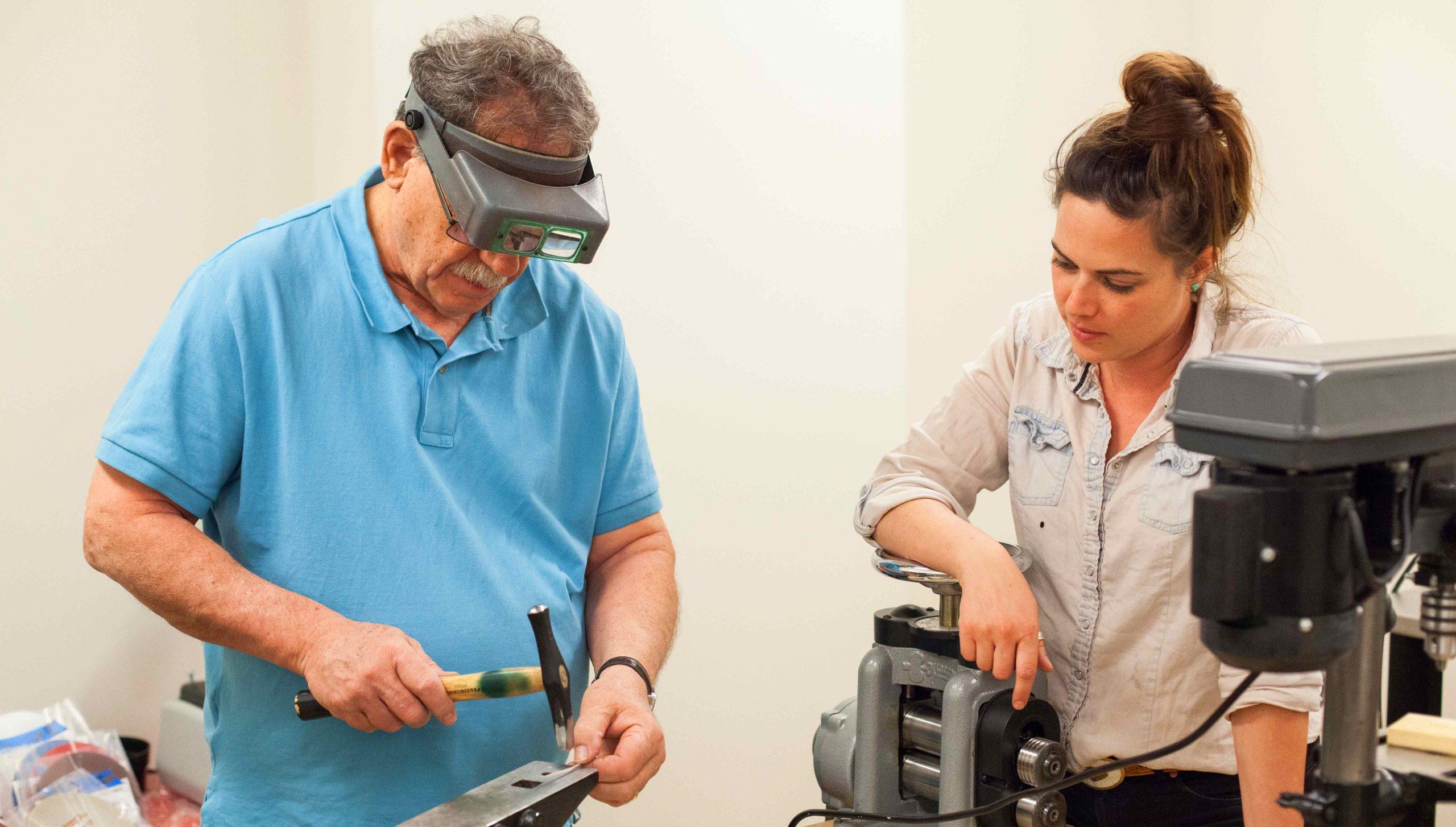 Randy Burns and Hilary Muramoto working in the metalsmithing workspace