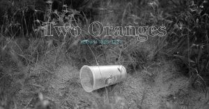 Photo of a Wendy's cup in some weeds with the words Two Oranges, Kolean 10.29-12.27