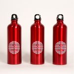 Red water bottles that have the MorphoTransverse Method logo on them