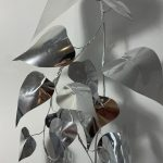 Image of a plant made out of a reflective silver material.