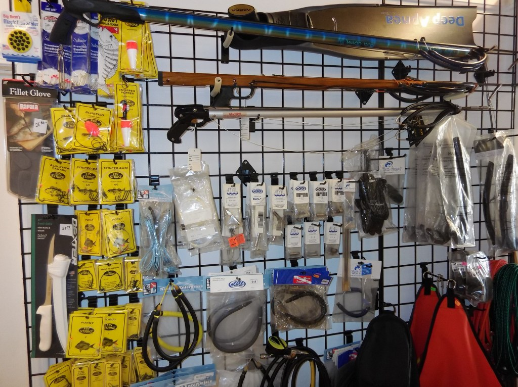 wall of spearfishing gear