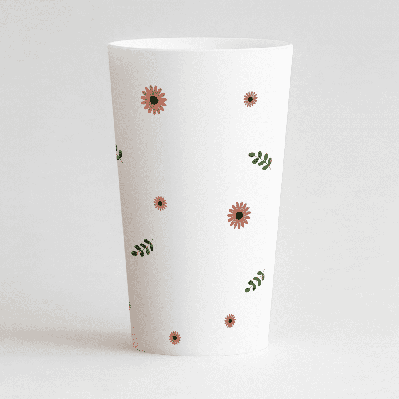 Un ecocup blanc de dos avec des fleurs et des feuilles et une couronne sur l'avant