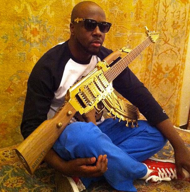 Deadly-AK-47-Assault-Rifle-Altered-Into-An-Golden-Guitar