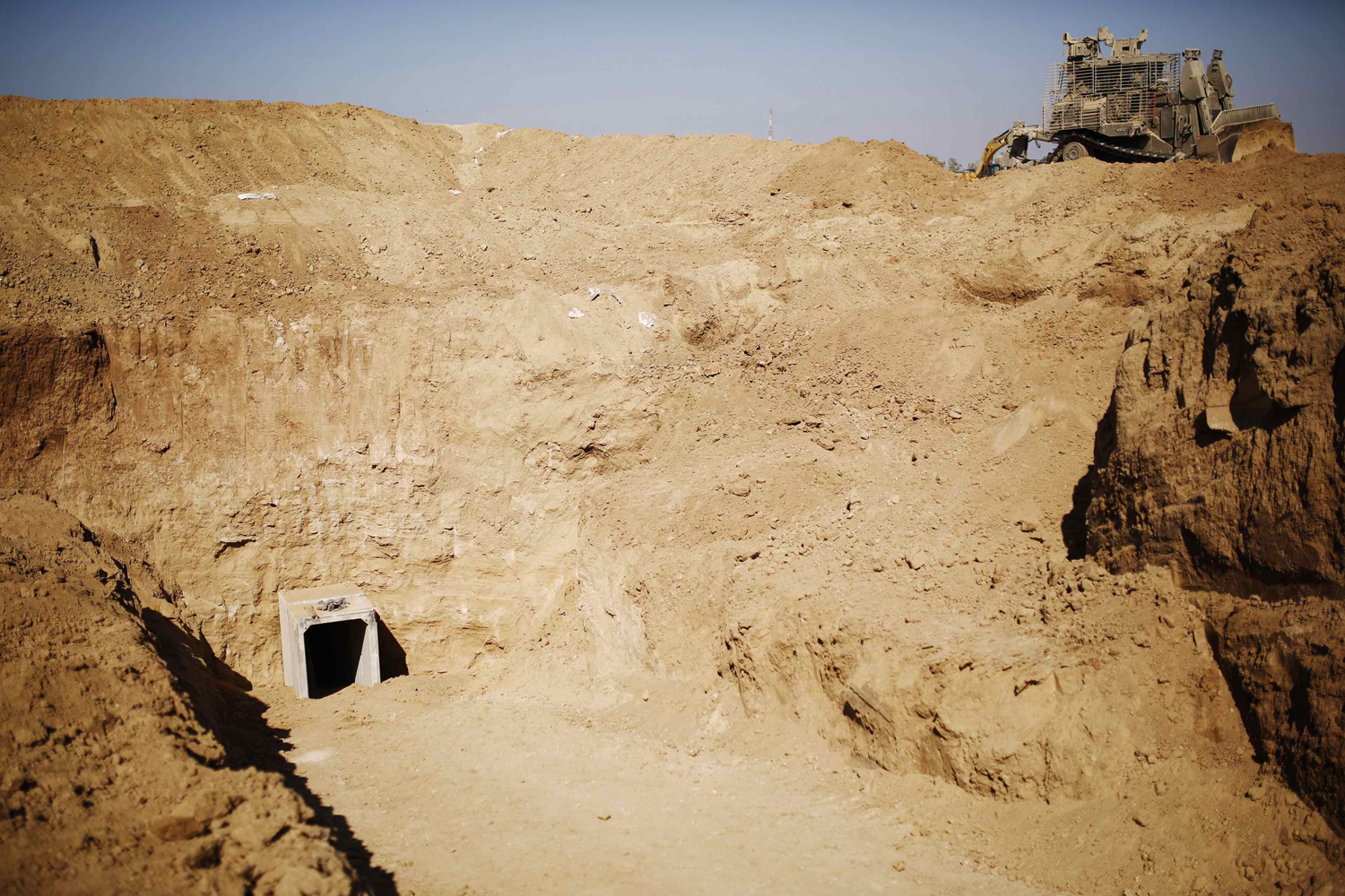 Image: An entrance to a tunnel exposed by the Israeli military is seen near Kibbutz Ein Hashlosha, just outside the southern Gaza Strip