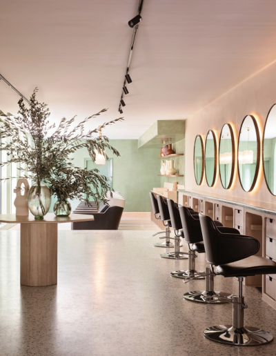 Headcase Hair Salon Sydney image of interiors of the salon, hairdressing chairs, hair work stations, mirrors and showing the interior design