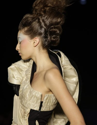 Australian Fashion Week Sydney model posing with modern beehive upstyle hairstyle with brunette hair colour