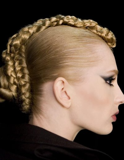 Fashion week Sydney Australia plait upstyle hairstyle with a bun on a model with blonde golden hair