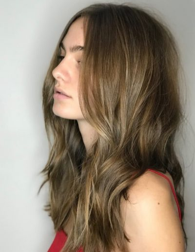 Girl with wavy hairstyle and long layered haircut with Bronde hair colour at Headcase Hair Potts Point Sydney