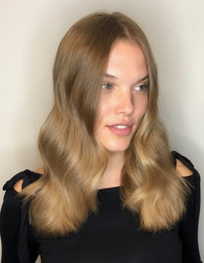 Girl with center part hairstyle and long layered haircut at Headcase Hair Potts Point Sydney