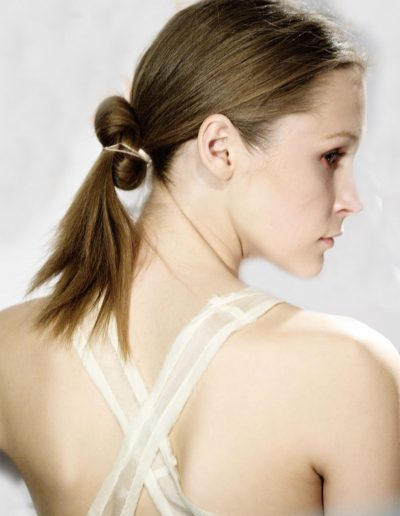 Fashion Week Sydney Australia model posing with a low ponytail twist long hair hairstyle light brunette in hair colour