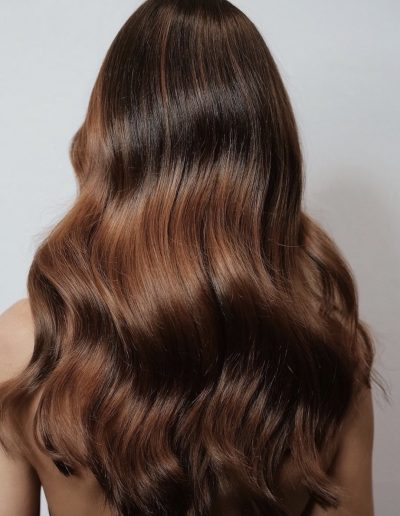 Hair picture of hair extensions on long brunette wavy hair done by Headcase Hair Paddington Sydney