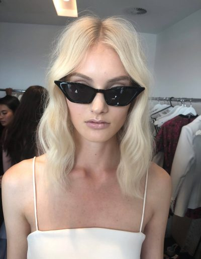 Fashion Week Sydney Australia backstage image girl with center part hairstyles and wavy long hair with bleach blonde hair colour