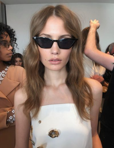 Fashion Week Sydney Australia backstage image girl with center part hairstyles and wavy long hair with brunette hair colour