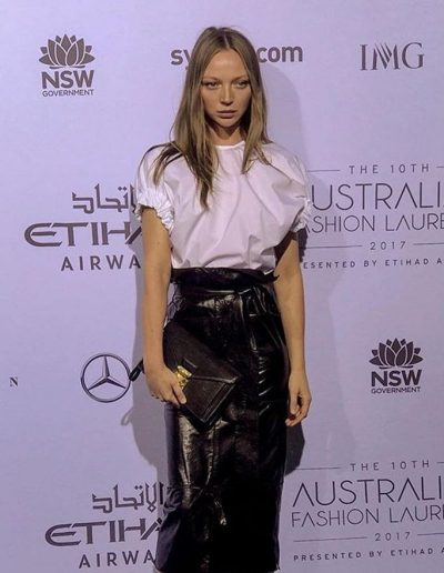Model posing for Australian Fashion Week Sydney with center part hairstyle and bronde hair colour
