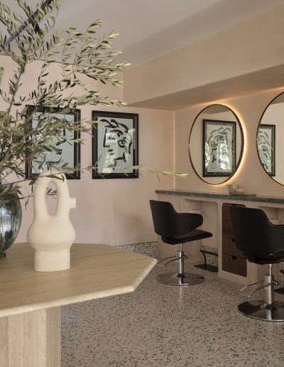 Headcase Hair Salon Sydney image of interiors of the hair stations, hairdressing chairs, mirrors, art work and interior design