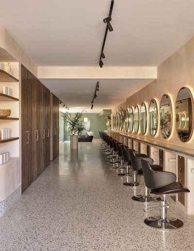 Headcase Hair Salon Sydney image of interiors of the salon, hairdressing chairs, hair products and retail shelves and showing the interior design