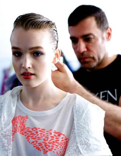 Fashion week Sydney Australia Model with slick back hairstyle with a low pony tail with brunette hair colour and John Pulitano from Headcase Hair Sydney doing her hair