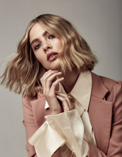 Vogue Australia hair article image of girl with a long bob lob haircut and blonde highlights and balayage hair colour. Hairstyle in soft waves