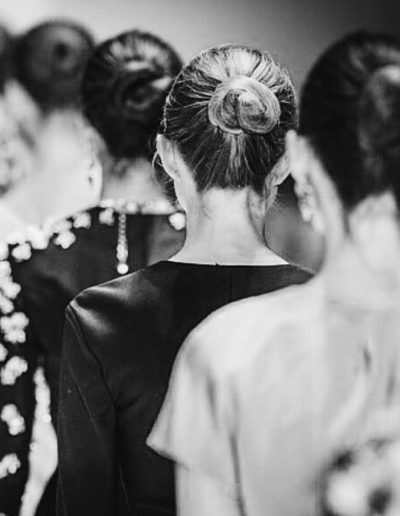 Fashion Week Sydney Australia models on the runway showing back of hairstyles in a slick back bun