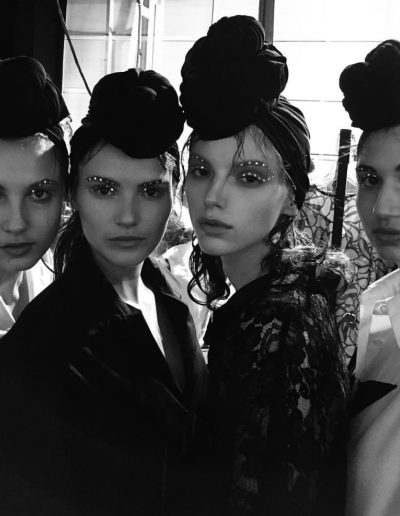 Fashion Week Sydney Australia four models pose with top knot hair accessories and some hair on the face