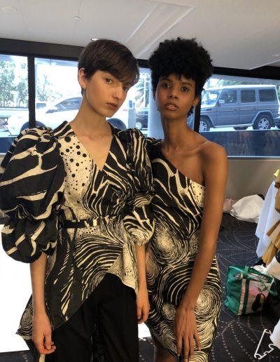 Australian Fashion Week Sydney two models pose with short hair cuts both with dark brown hair colours