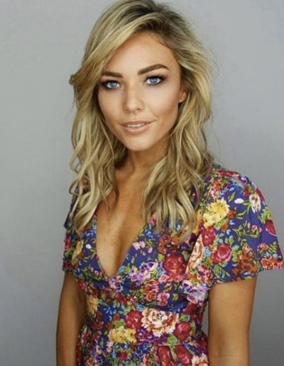Sam Frost with blonde highlights and balayage hair colour. Side parting with soft waves and hair extensions