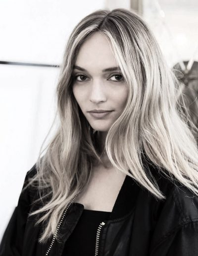 Fashion week Sydney Australia image of a girl with a center part hairstyle, long hair styled with soft waves and blonde balayage with face frame highlights