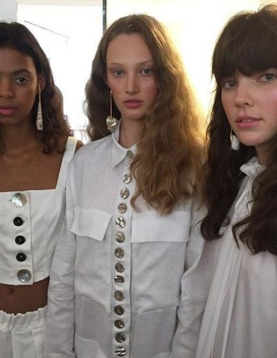 Fashion Week Sydney Australia three models with with soft curl hairstyles and one with a strong hair fringe