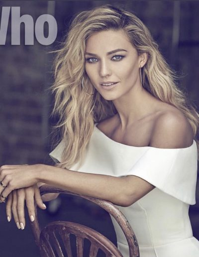 Sam Frost image in Who with blonde highlights and balayage hair colour. Side parting with soft waves and hair extensions