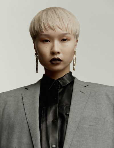Vogue Australia a girl with a short haircut and bowl straight hairstyle with bleach blonde hair colour on Asian hair